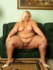 Melinda Timid playfully stripping her clothes and unveiling her gigantic folds of fat