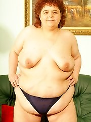 Mature plumper slowly stripping off her clothes to display off her belly and get in a hot threeway