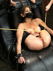 This lusty whore is quivering in her chains. every part of her is trussed down and completely immobile. Her breasts are firmly bound in leather straps and the flogging goes after.Next her booty and pussy are exposed with her legs roped behind her head. Mz Berlin and Mz Adams flog her viciously and torment her cunt with a vibrator.Eventually in a visually dramatic pose the whore is roped over a barrel in a helpless backbend. Nasty surprises throughout...