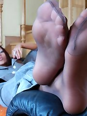 Hot business lady puts off her pantyhose aching for some rest for her feet