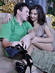 Hot doll takes off stilettos to rub and drain manmeat with her nyloned feet