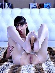 Anal-loving chick stuffs her ass thru tights boasting soft nylon clad feet