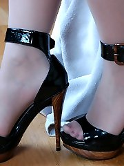Awesome babe thoroughly explores her pedicured feet encased in sheer nylon