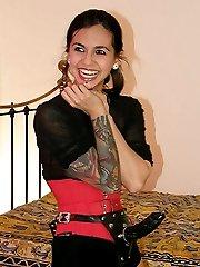 Femdom Holly D makes a slutty crossdresser gag on her strapon