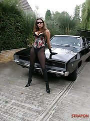 Strapon Jane posing outdoors infront of wondrous  mustang car