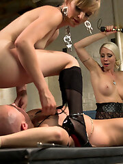 Lorelei Lee and Mona Wales drag disrespectful cat caller down to their dungeon to put him in his place. They humiliate, and punish him with Cbt, flogging, cable-on nailing before sitting on his face and using him as their personal play thing.