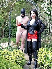 Leather Domme's Plaything Boy