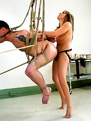 Lexi Love is a gorgeous, new Domnatrix to MIP but she is right at home beating men and fucking them up the ass with her huge strap on cock.  Rico takes all of her giant cock in his ass while tied up and suspended, and begs for more opportunity to please the demanding Mistress, like eating her pussy and giving her a hard cock to ride, all while enduring the pain she gives him in exchange for the little pleasures.