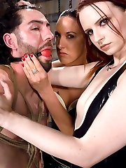 Mistress Claire has a new apprentice for the day.  Fiona is new to MIP, but she is mean and horny enough to dish out a good round of erotic abuse to our slave for the say, Omar.  Two mistresses torment Omar with strap on fucking, bondage and sex.