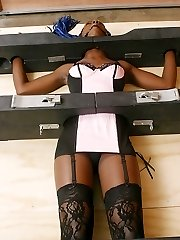 Restrain Bondage virgin Lexy gets locked in a device on the floor. Watch this spectacular damsel in distress struggle even tho her neck, mitts, torso and feet are padlocked.
