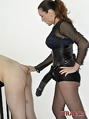 Strapon Jane tears up her submissives face with her strap on dildo before unleashing the big gun on his tight rump
