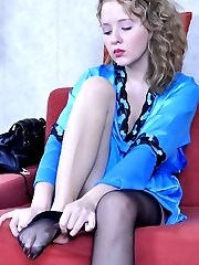 Pretty curly-head smoothing black Cuban heel stockings on her shapely legs