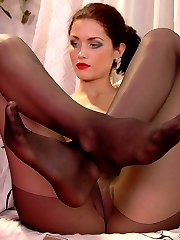 Smashing chick stripping up to her soft pantyhose to play nasty foot games