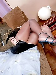 Cutie spreading her cheeks with hands while posing in slight sheen tights