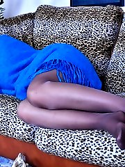 Foxy babe gives a nylon footjob spotting her guy wanking with high heels