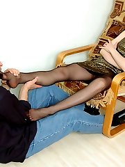 Kinky chick giving wild footjob before getting her black tights cum-covered