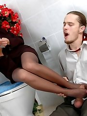 Pantyhosed business woman giving a smashing footjob right in the bathroom