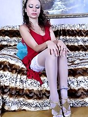 Slim-legged girl licks her silky smooth white stockings and pets her pink