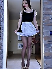 Naughty maid in hot lacy nylons plays with a strapon instead of tidying up