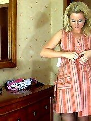 Heated blonde admiring the look of her black nylons and animal print garter