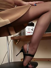 Pony-tailed chick in soft silky pantyhose making a show of her foot games