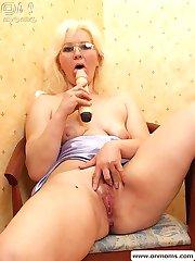 Blonde mature teacher with big tits masturbating with huge dildo