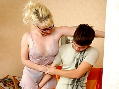 Frisky milf in see-thru slip luring a lad to have a few rounds in the hay