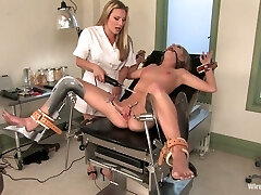 Lezzy gynecologist puts on strapon and fucks raw pussy of Jaelyn Fox