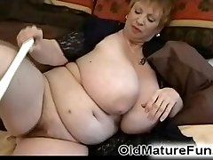 Chubby granny playing with a toy