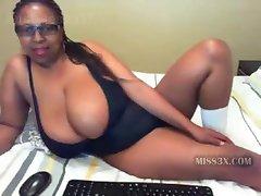 Ebony mommy and her mega big boobs