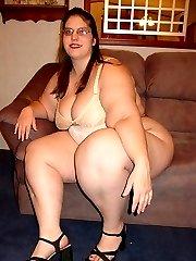 Big butt BBW brunette strips to white panties