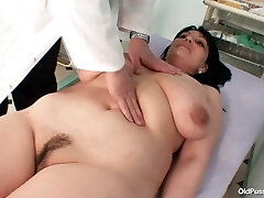 Gyno specialist examines saggy tittied black-haired