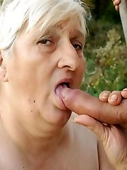 Naughty mature granny Szandra exposing her huge BBW outdoors and fucking a younger dude