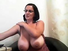 MILF with glasses flashes her fat boobs