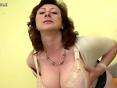 Huge boobed mother Jana loves to play with her fur covered pussy