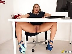Round English nymphomaniac Ashley Rider touches her meaty pussy in the office