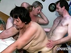 Mischievous mom enjoys lesbian fun in bed