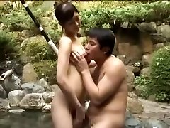 Breasty slut pummeling an Asian boy in a pool