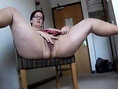 Big-titted mature BBW in pantyhose and mini micro-skirt