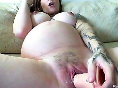Knocked Up brunette slutty drains with huge dildo