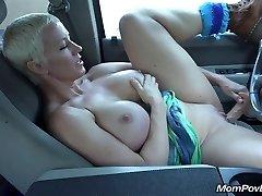 Good-sized tit MILF masturbates in car