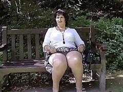 Taking off her knickers in the park