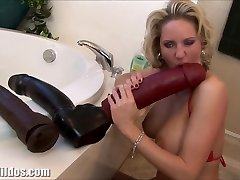 Busty milf pumping out from a huge faux-cock