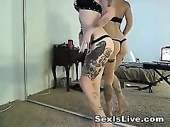 Gothic tattooed ash-blonde in undergarments is playful