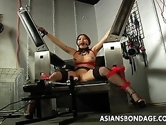 Huge-boobed brown-haired getting her wet pussy machine fucked