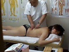 Medical voyeur rubdown video starring a plump Asian wearing dark-hued panties