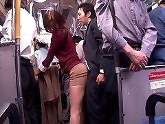 Japanese bitch deep-throats dick in a public bus