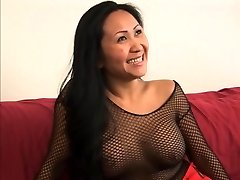 Guy gets a sole job from a cute asian in fishnets