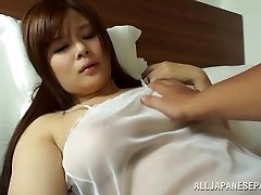 Japanese AV Model is a steamy cougar in transparent lingerie
