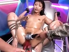 Tied Asian slut gets stimulated by toys to climax